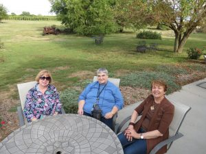 Judy Nelson, Jill Claflin and Glennis Nagel enjoy the view at Burchell's White Hill Farmhouse Inn, site of NPW's fall convention.